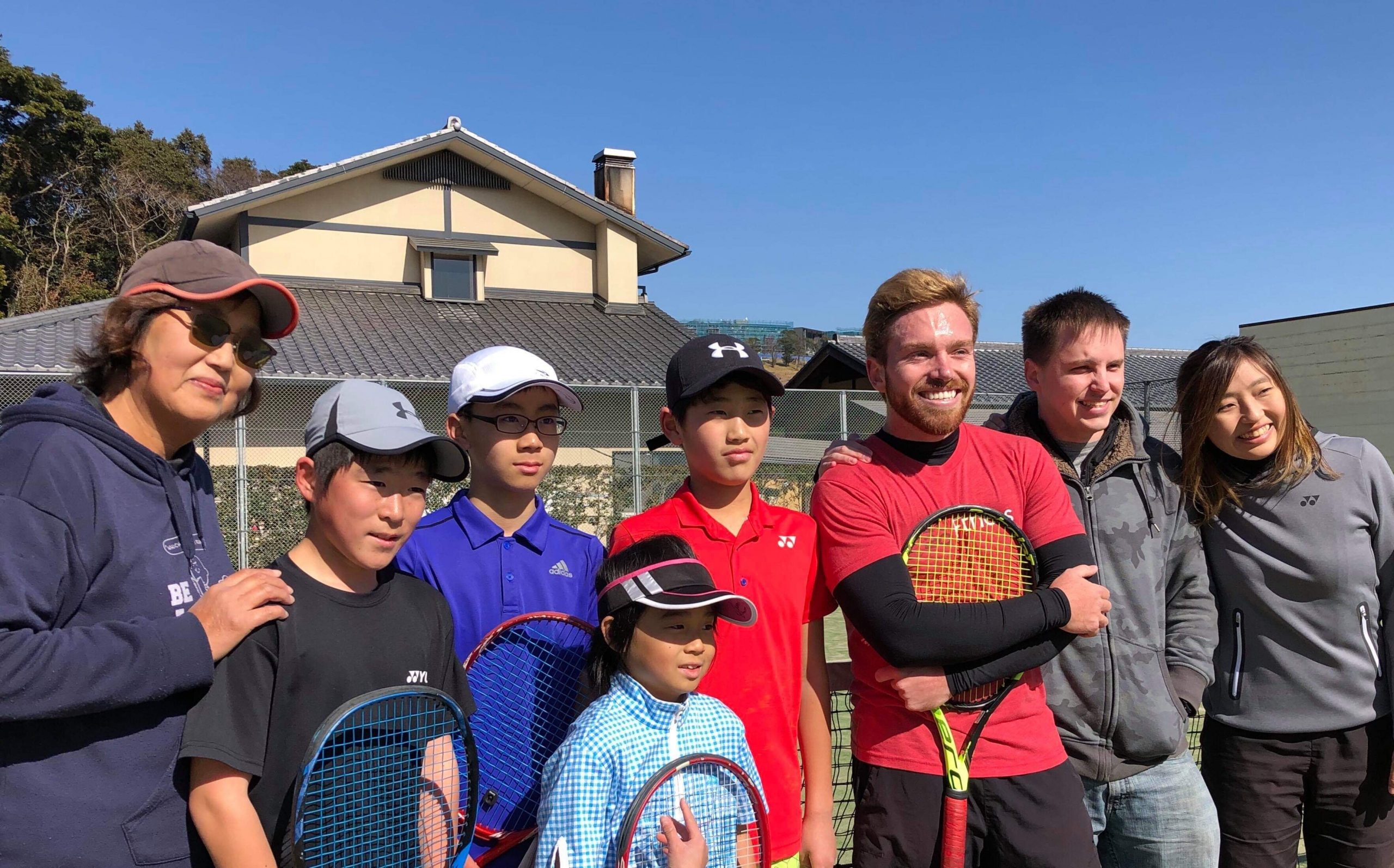 tennis group taking a group photo