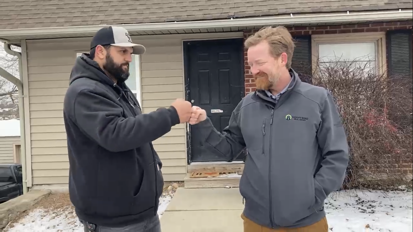 inspector and realtor fist bumping