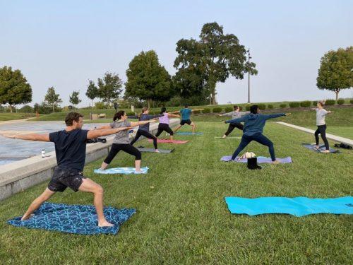 group of people doing yoga outside