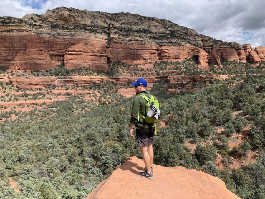 man looking out at canyon
