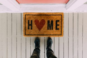 welcome home mat by front door