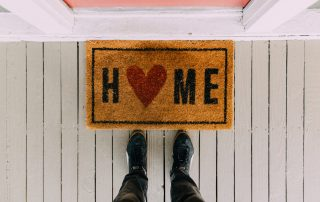 welcome home mat by front door